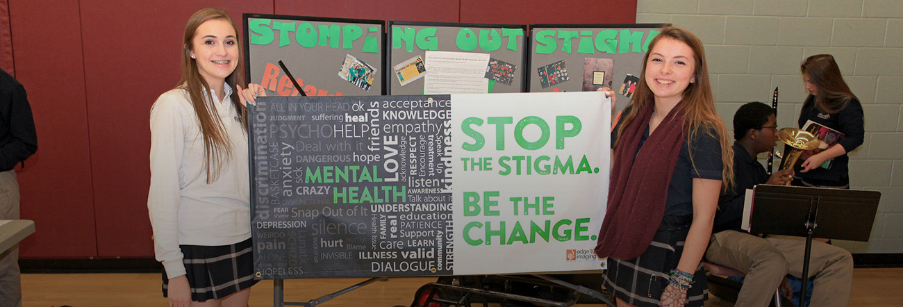 Two girls standing in front of Mental Health display