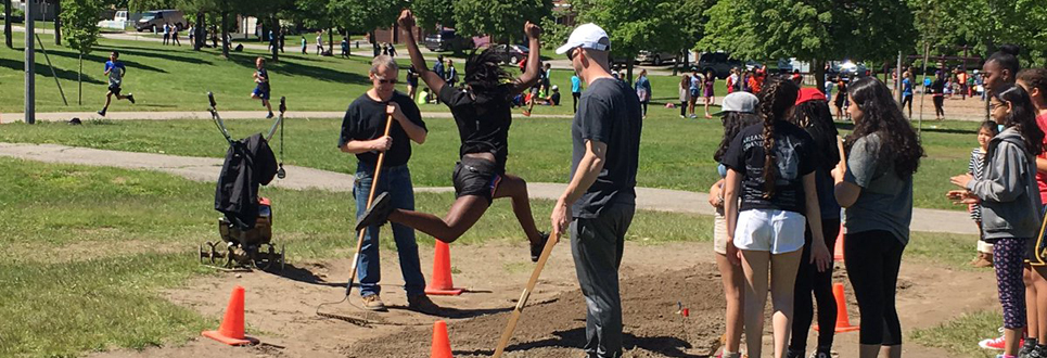 students competing in track and field activities outside