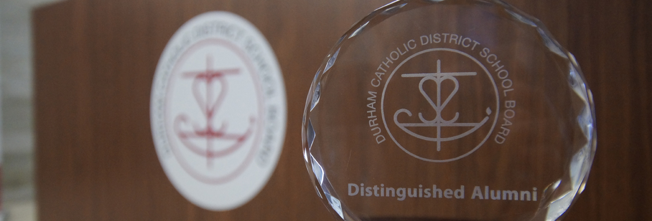 Glass award with Board's logo with words Distinguished Alumni