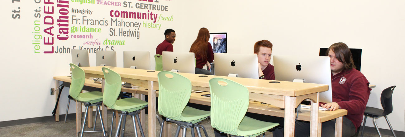Male students on iMac computers
