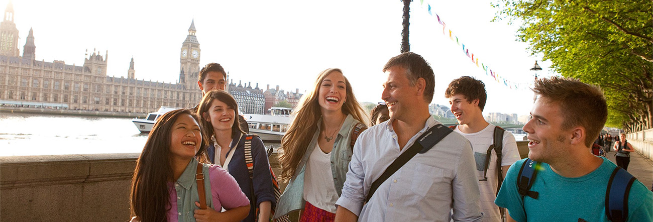 male and female students with male adult in London, England