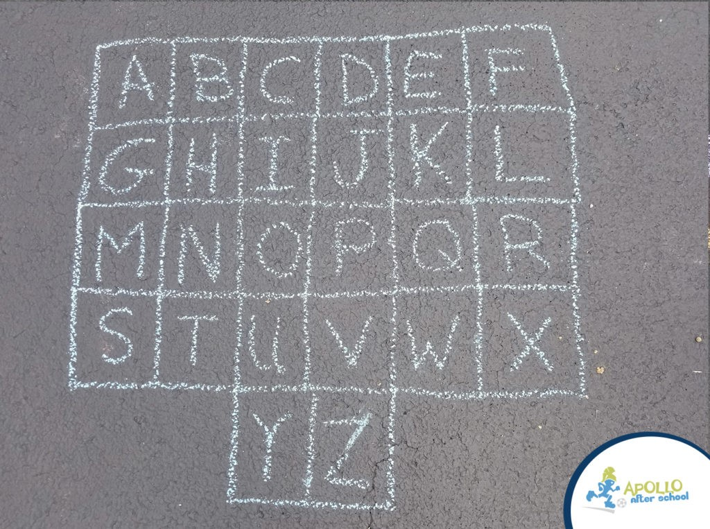Alphabet drawn out on chalk on a driveway